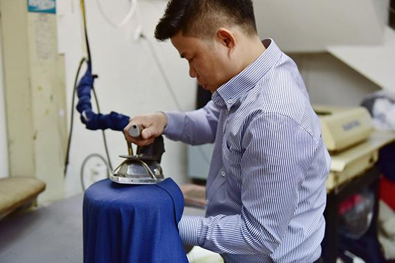 Discuss how to clean and ironing a Bespoke suit